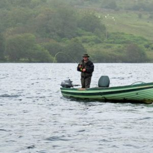 Our Guide Tommy playing another salmon on the lough